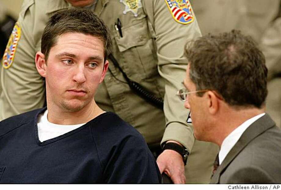** RETRANSMISSION TO CORRECT LEFT TO  RIGHT ** Johannes Mehserle, left, talks with his attorney Christopher Miller in the East Fork Justice Court on Wednesday morning, Jan. 14, 2009, in Minden, Nev. Mehserle is being held on charges related to the New Year's day shooting of an unarmed man on an Oakland, Calif., train platform. Mehserle, 27, waived extradition to California early Wednesday during a brief court appearance in Minden, Nev., and was being held without bail on a warrant charging homicide. Douglas County Sheriff's Deputy Ron Mills is at left. (AP Photo/Cathleen Allison) Photo: Cathleen Allison, AP