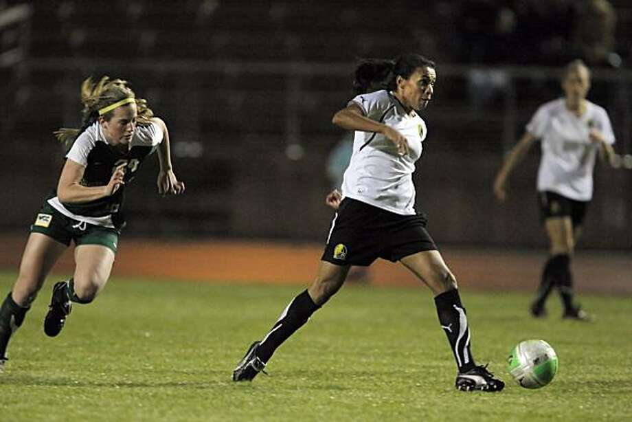 Marta of the FC Gold Pride moves the ball upfield during an exhibition match against University of San Francisco at Kezar Stadium in San Francisco, Calif., on Thursday, March 25, 2010. Marta is a Brazilian soccer player considered one of the best players in the world. She became a YouTube legend during the last women's World Cup, thanks to her dazzling moves. Photo: Carlos Avila Gonzalez, The Chronicle