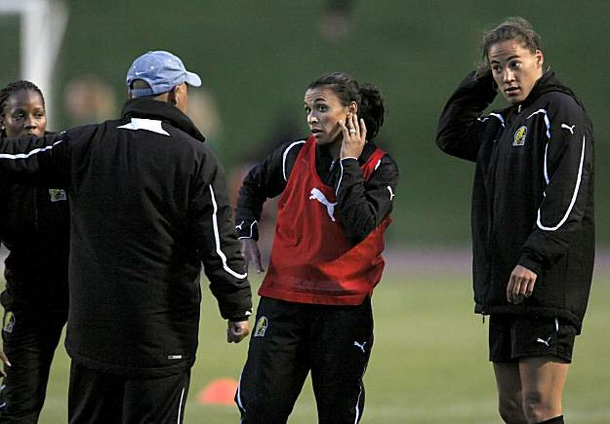 FC Gold Pride teammates, Kandace Wilson, left, Marta, center, and Niki Cross, listen to a coach during warm up drills before an exhibition match against University of San Francisco at Kezar Stadium in San Francisco, Calif., on Thursday, March 25, 2010. Marta is a Brazilian soccer player considered one of the best players in the world. She became a YouTube legend during the last women's World Cup, thanks to her dazzling moves.