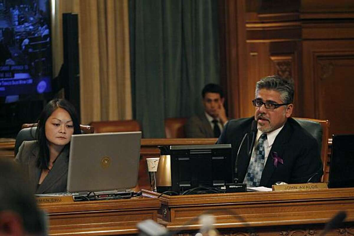 Supervisor John Avalos (right) speaks during a during a San Francisco Board of Supervisors meeting at City Hall in San Francisco, Calif. on Tuesday May 4, 2010. Supervisor Carmen Chu (left) looks at her computer.