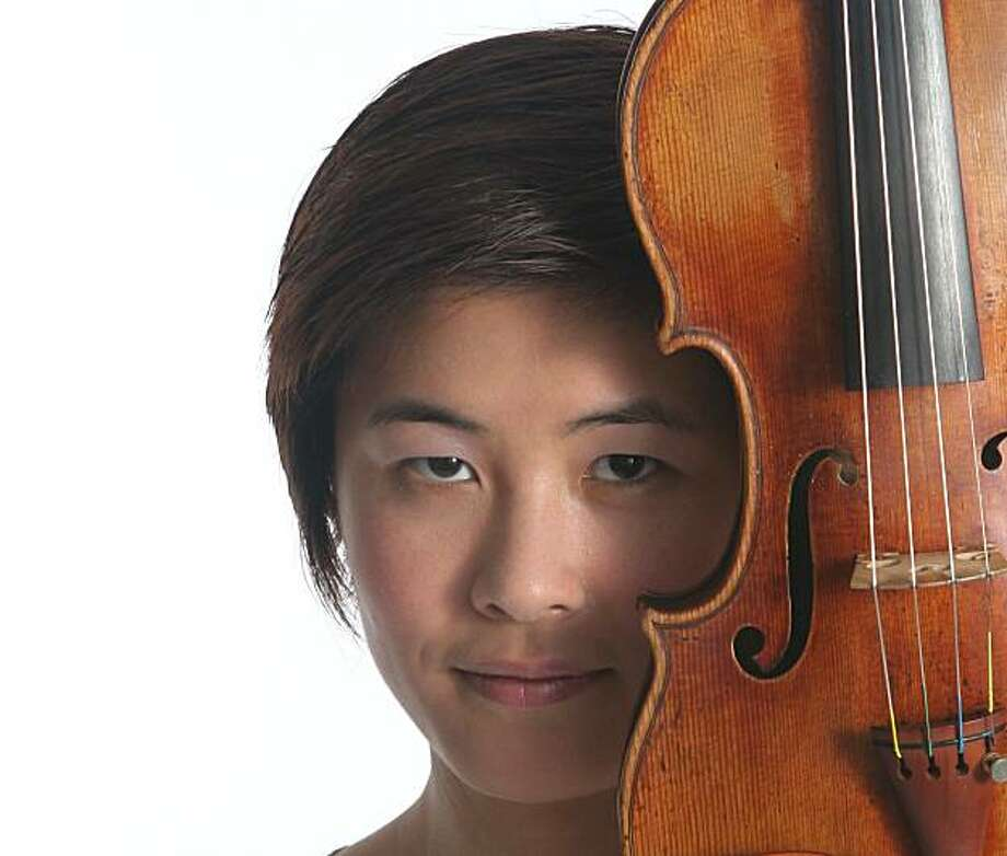 Violinist Jennifer Koh will perform with the Berkeley Symphony Orchestra on Sept. 23 at Zellerbach Hall at UC Berkeley. Photo: Janette Beckman