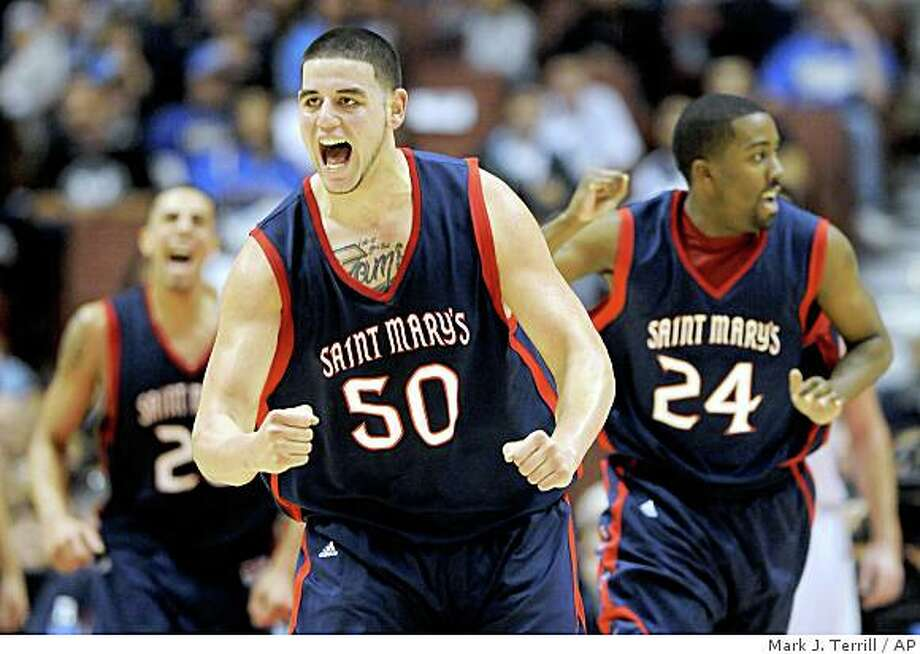 ** CORRECTS TO OMAR SAMHAN NOT OMAR SAMHAM ** ** ADVANCE FOR WEEKEND EDITIONS, JAN. 25-25 ** FILE ** In this Dec. 13, 2008, file photo, Saint Mary's Omar Samhan, center, pumps his fist after scoring, while teammates Diamon Simpson, left, and Wayne Hunter also celebrate during an NCAA college basketball game against San Diego State at the John Wooden Classic  in Anaheim, Calif. Samhan and Simpson make up one of the top post tandems in the West Coast Conference and perhaps in the nation--and they hope to get the Gaels back in the NCAA tournament come March. (AP Photo/Mark J. Terrill,file) Photo: Mark J. Terrill, AP