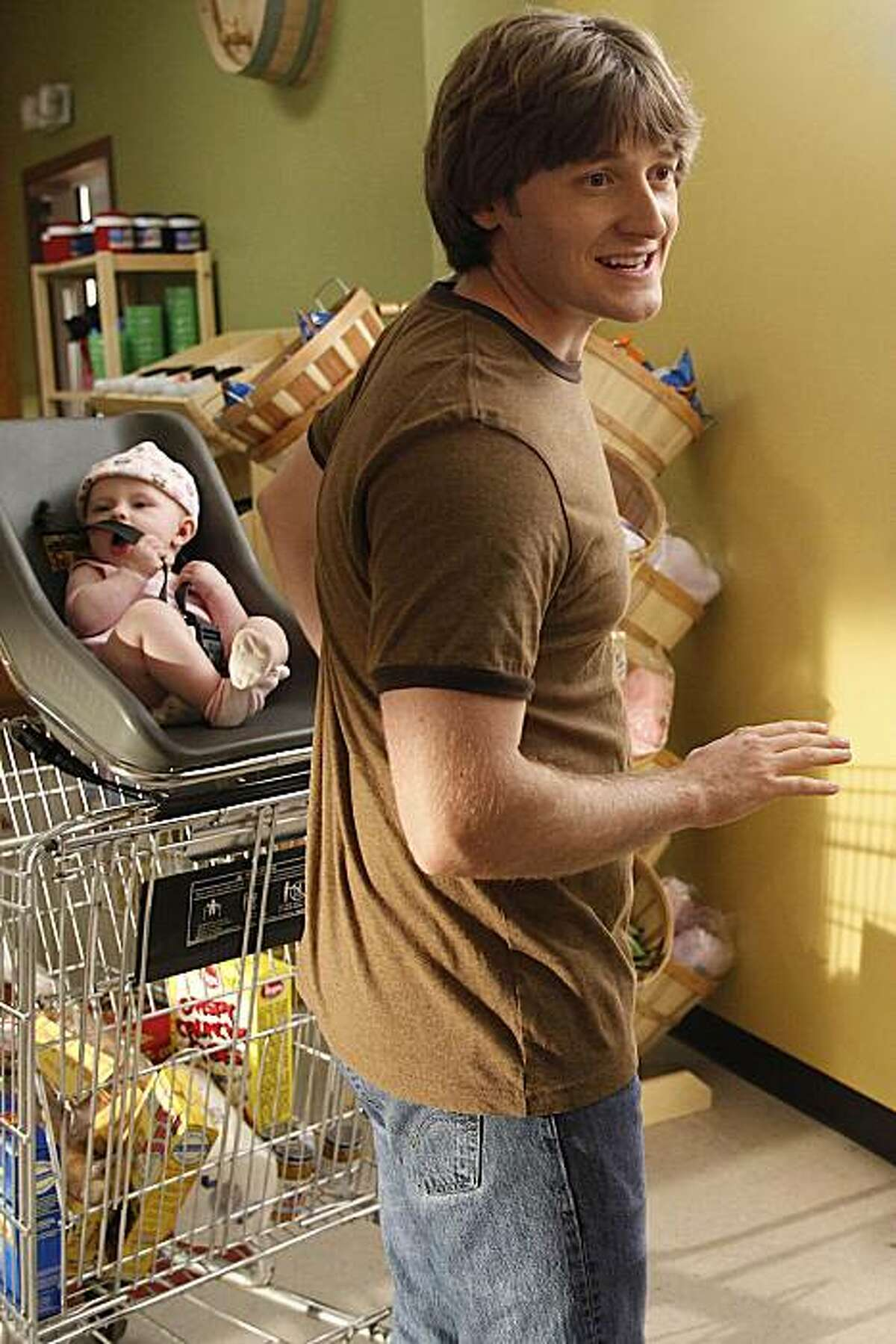 RAISING HOPE: Jimmy (Lucas Neff) hangs out at the grocery store hoping to see Sabrina, in the RAISING HOPE episode