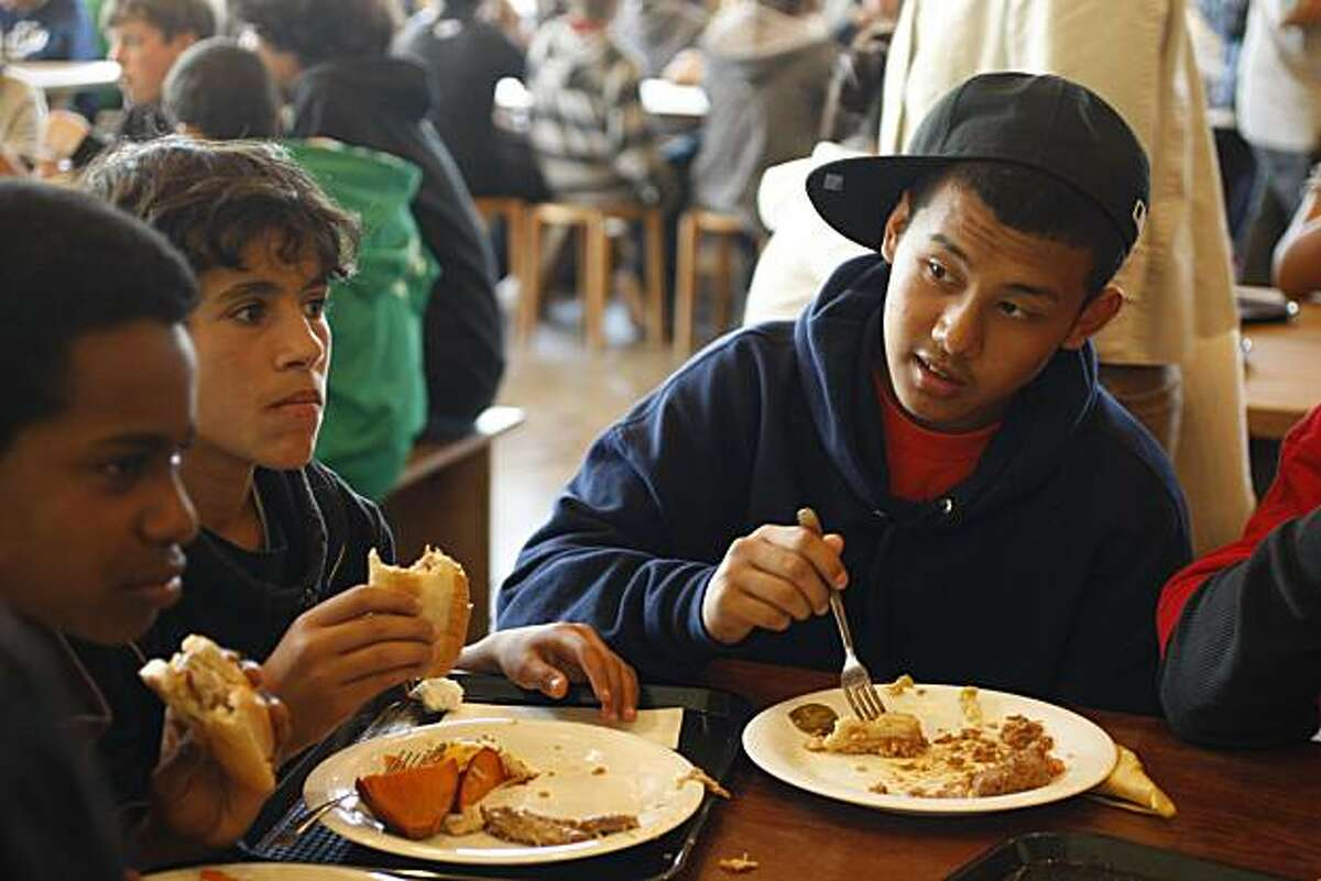 Tenzin Sangay (right, wearing ball cap), 14, and Mohammed Aledlah, 14 (left), next to Tenzin Sangay during lunch at Martin Luther King, Jr. Middle School in Berkeley, Calif., on March 24, 2009.