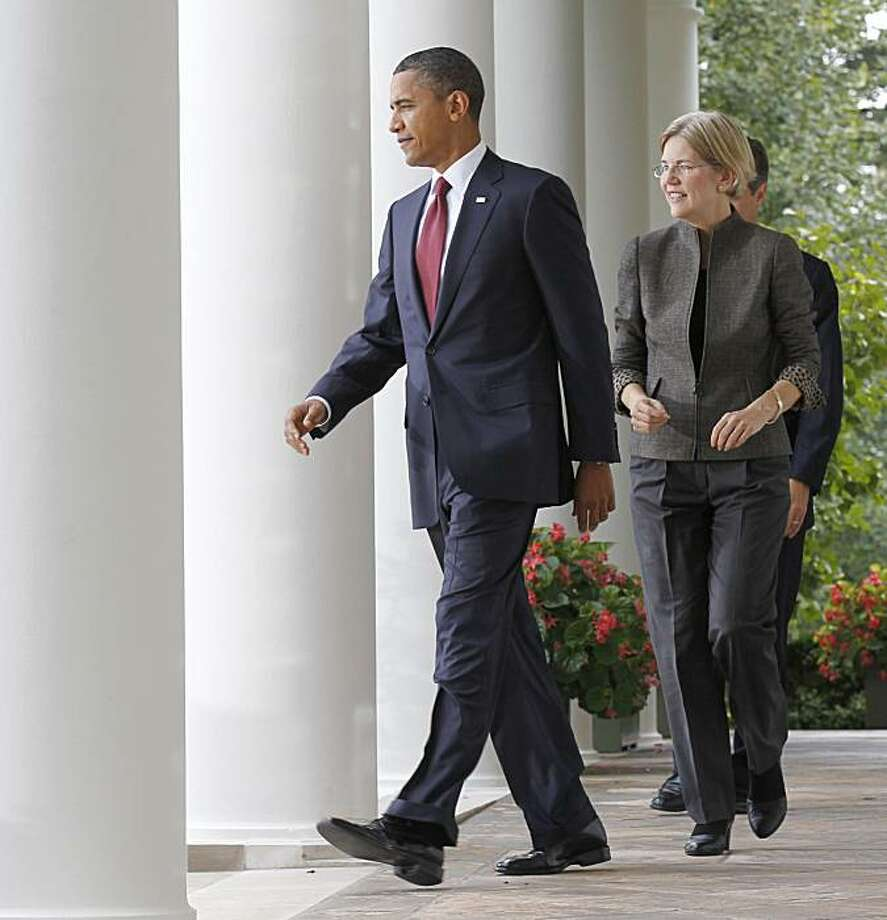 President Barack Obama, followed by Elizabeth Warren and Treasury Secretary Timothy Geithner, walks to the Rose Garden of the White House in Washington, Friday, Sept. 17, 2010, to announce that Warren will head the Consumer Financial Protection Bureau. Photo: Pablo Martinez Monsivais, AP