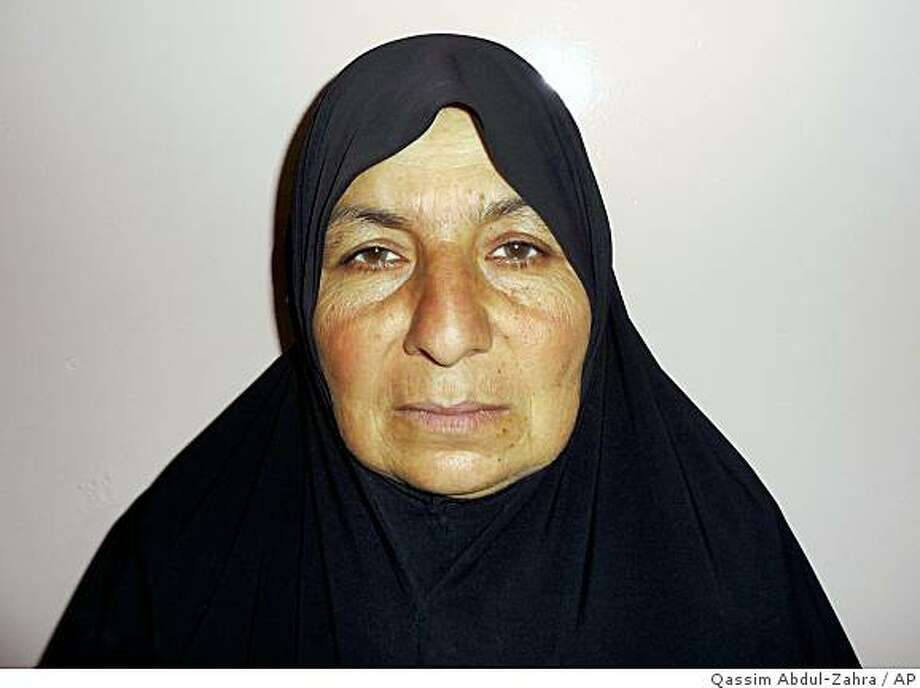 "** ADDS DATE OF ANNOUNCEMENT  ** Samira Ahmed Jassim is seen in a detention facility in Baghdad, Iraq, Monday, Jan. 27, 2009. The woman, nicknamed ""Umm al-Mumineen,"" suspected of recruiting more than 80 female suicide bombers has been arrested, the Iraqi military said Tuesday Feb. 3, 2009, dealing a major blow to one of the most effective forms of attacks in Iraq. Iraqi military spokesman Maj. Gen. Qassim al-Moussawi said the suspect had recruited more than 80 women willing to carry out attacks and had admitted masterminding 28 bombings in different areas. (AP Photo/Qassim Abdul-Zahra) Photo: Qassim Abdul-Zahra, AP"