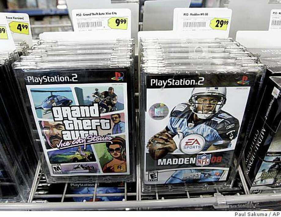 "Obtaining Take-Two would help EA keep pace with Activision Blizzard, the merger between Ac?tivision and Vivendi Games. It also would add huge moneymakers like Grand Theft Auto.Electronic Arts video game Madden 08 is on display next to Take-Two Interactive Software video game Grand Theft Auto at Best Buy in Mountain View, Calif., Monday, Feb. 25, 2008. Video game maker Electronic Arts Inc. on Monday urged the publisher of ""Grand Theft Auto"" to quickly accept its unsolicited $2 billion takeover bid, saying it's only a matter of time before it declares ""game over"" and pulls its premium offer.  EA wants an agreement on a deal before the release of ""Grand Theft Auto IV."" Take-Two Interactive Software Inc. says it's willing to talk, but only after the next installment of its popular crime game goes on sale in April. (AP Photo/Paul Sakuma) Photo: Paul Sakuma, AP"