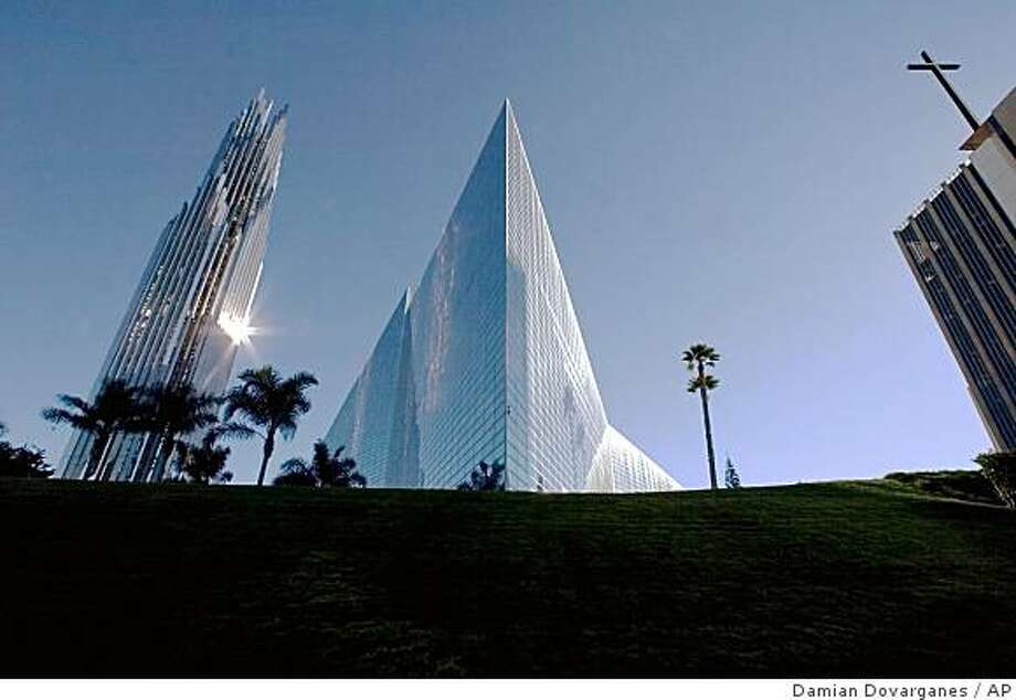 "** FILE ** The Crystal Cathedral is seen Friday, Dec. 17, 2004, in Garden Grove, Calif. Just three years after the changeover of leadership from Robert H. Schuller to his son, Robert A. Schuller, for the Crystal Cathedral, a bitter family feud has left the younger Schuller in exile, a rotating roster of visiting preachers fills the ""Hour of Power,"" and the church itself is mired in debt, with donations dropping. (AP Photo/Damian Dovarganes, File) Photo: Damian Dovarganes, AP"