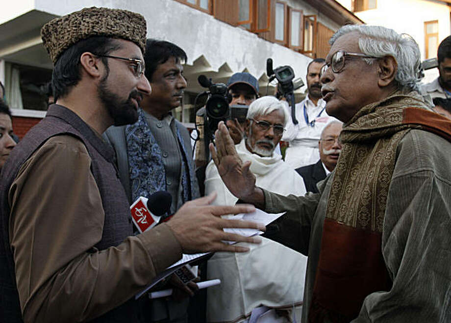Kashmiri separatist leader Mirwaiz Umar Farooq left, talks to Indian lawmaker Gurdas Dasgupta as a delegation of Indian lawmakers called on him at his residence in Srinagar, India, Monday Sept. 20, 2010. A delegation of Indian lawmakers launched a missionMonday in Kashmir to find ways of defusing months of deadly unrest, but their trip was immediately derided by the Himalayan region's separatists as a publicity stunt. Photo: Mukhtar Khan, AP