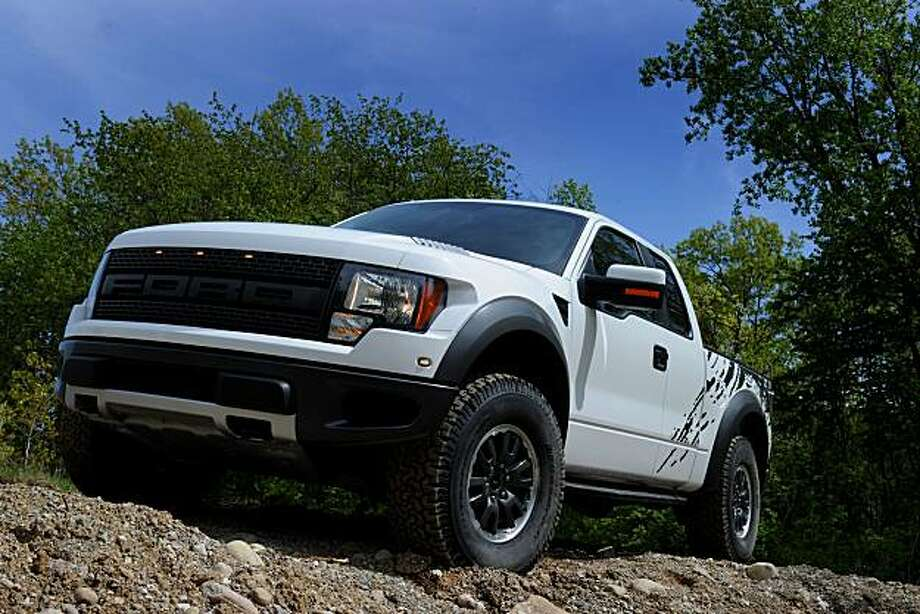 """Ford's 2010 F-150 SVT Raptor 4x4 is inspired by the """"R"""" version -- a bona-fide desert-racing pickup. It wears a bold grille that's clearly different from the grille of any other pickup. Pricing starts at $38,260. Power is pumped up with a new 6.2-liter V8option. Photo: Courtesy Of Ford"""