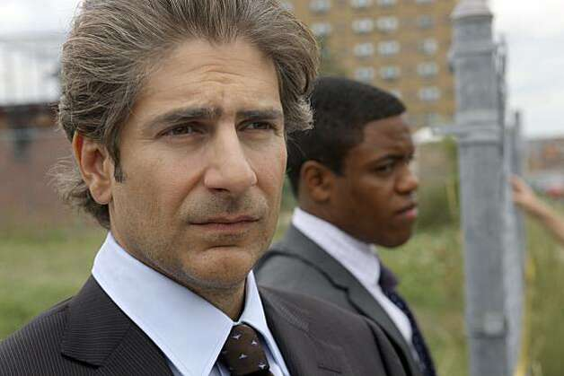 "In this publicity image released by ABC, actors Michael Imperioli, left, and Jon Michael Hill are shown during filming of ""Detroit 1-8-7"" in Detroit, Aug. 17, 2010. The first network television drama to set up shop full-time in Detroit is discovering a city that goes beyond its Rust Belt reputation. Photo: Mark H. Preston, AP"
