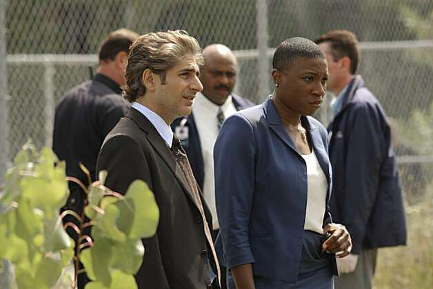 "In this publicity image released by ABC, Actors Michael Imperioli, left, and Aisha Hinds are shown during filming of ""Detroit 1-8-7"" Aug. 17, 2010 in Detroit. The first network television drama to set up shop full-time in Detroit is discovering a city that goes beyond its Rust Belt reputation. Photo: Mark H. Preston, AP"