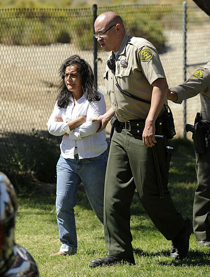 Reyna Chicas, the leader of a breakaway religious sect, is taken in for questioning after her group was located by Los Angeles County Sheriffs officers at Jackie Robinson Park, outside Palmdale in Littlerock, Calif., Sunday, Sept. 19, 2010. The group wasfound praying at the park Sunday, halting a frantic search for the five adults and eight children who went missing after writing letters to family members saying goodbye. Photo: Gus Ruelas, AP