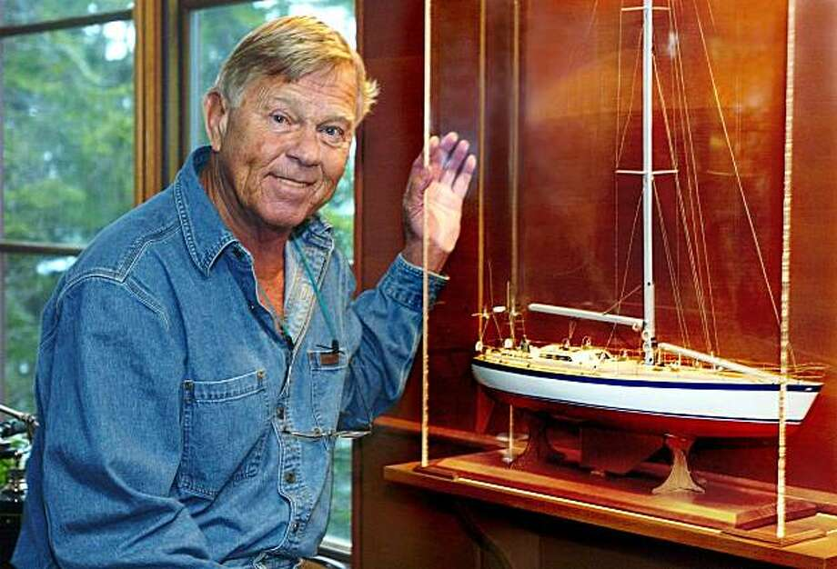 This photo made April 5, 2005, shows Dodge Morgan next to a model of his boat, American Promise.  Morgan, the first American to complete a solo sail around the globe without stopping, died Tuesday, Sept. 14, 2010,  of cancer, at a Boston hospital. He was 78. (AP/Portland Press Herald, Gordon Chibroski) Photo: Gordon Chibroski, AP