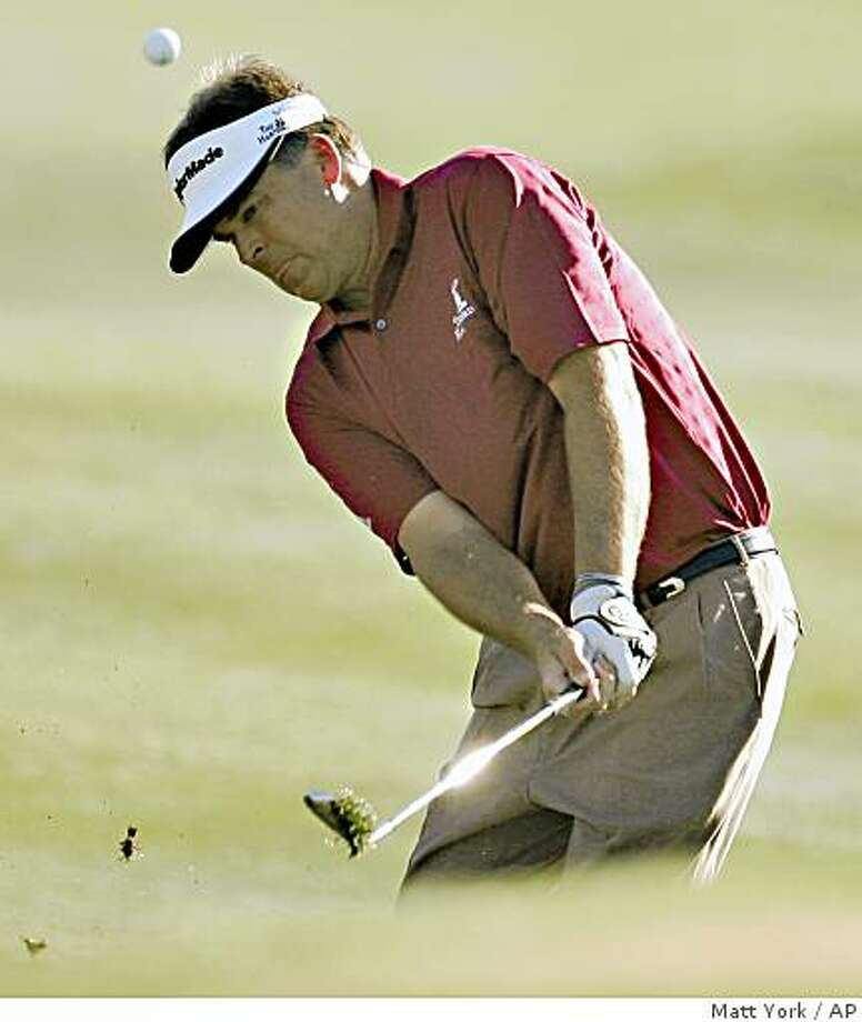 Kenny Perry hits onto the 18th green during the final round of the FBR Open golf tournament Sunday, Feb. 1, 2009, in Scottsdale, Ariz. Perry won the tournament on the third playoff hole. (AP Photo/Matt York) Photo: Matt York, AP