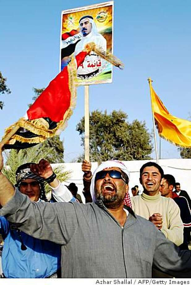 Sunni Muslim Iraqis and members of the Sahwa or Sons of Iraq celebrate following yesterday's provincial elections in the western Anbar town of Ramadi, 100 kms from the capital Baghdad on February 1 2009. In Anbar, once the hotbed of the anti-US insurgency, up to 40 percent of the electorate cast ballots, a massive jump from less than one percent in the last elections in 2005. Sahwa or Sons of Iraq, mostly former insurgents who fought US and Iraqi forces after dictator Saddam Hussein's fall in 2003, but have helped curb violence since late 2006 when they started helping the Americans to battle Al-Qaeda.  AFP PHOTO / AZHAR SHALLAL (Photo credit should read AZHAR SHALLAL/AFP/Getty Images) Photo: Azhar Shallal, AFP/Getty Images