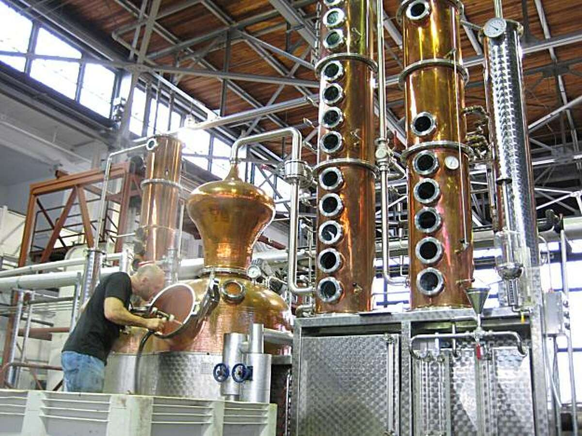Lance Winters works on the production of a Tequila-like spirit from blue agave known as Agua Azul St. George Spirits in Alameda, Calif.