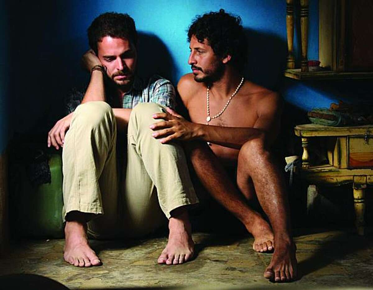"Cristian Mercado as Miguel and Manolo Cardona as Santiago appear in a scene from, ""Undertow."""