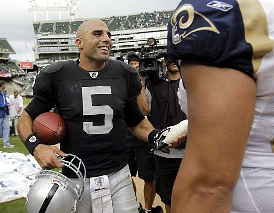 Oakland Raiders quarterback Bruce Gradkowski (5) smiles at a St. Louis Rams player after the Raiders defeated the Rams 16-14 in an NFL football game in Oakland, Calif., Sunday, Sept. 19, 2010. Photo: Paul Sakuma, AP