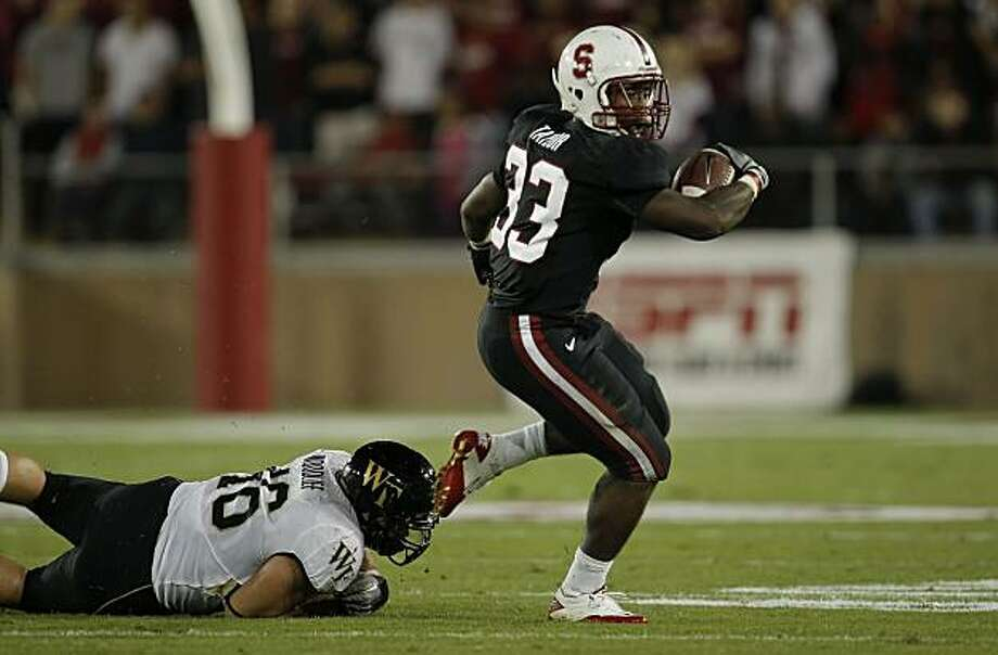 Stanford's Sepfan Taylor, (33) gets outside of defender Matt Woodlief, (46) on a first quarter run, as the Stanford Cardinal takes on Wake Forest in college football action at Stanford Stadium in Palo Alto, Ca. on Saturday Sept. 18, 2010. Photo: Michael Macor, The Chronicle