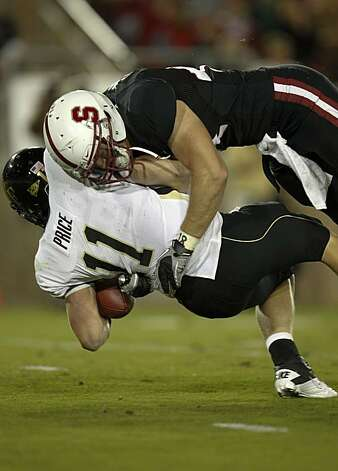 Stanford's Thomas Keiser, (94) sacks Wake Forest quarterback Tanner Price on a second quarter play,  as the Stanford Cardinal takes on Wake Forest in college football action at Stanford Stadium in Palo Alto, Ca. on Saturday Sept. 18, 2010. Photo: Michael Macor, The Chronicle