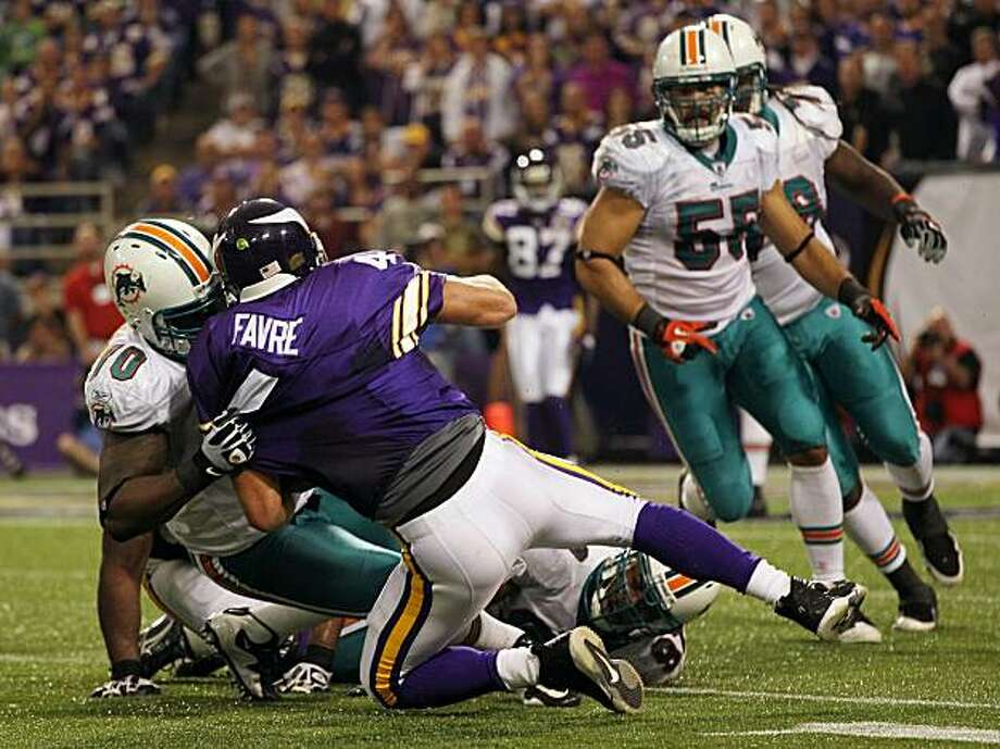 MINNEAPOLIS - SEPTEMBER 19:  Quarterback Brett Favre #4 of the Minnesota Vikings is sacked by Kendall Langford #70 of the Miami Dolphins during the second half of the game on September 19, 2010 at Hubert H. Humphrey Metrodome in Minneapolis, Minnesota. Photo: Jamie Squire, Getty Images