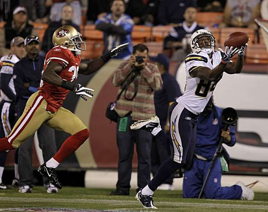San Diego Chargers wide receiver Buster Davis, right, makes a reception as San Francisco 49ers cornerback Phillip Adams, left, looks on during the second quarter of their NFL preseason football game in San Francisco, Thursday, Sept. 2, 2010. Photo: Marcio Jose Sanchez, AP