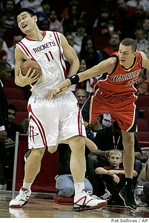 Golden State Warriors' Andris Biedrins, right, of Latvia, tries to slow down Houston Rockets' Yao MIng (11), of China, on his way to the basket during the first half of an NBA basketball game Saturday, Jan. 31, 2009, in Houston. Photo: Pat Sullivan, AP