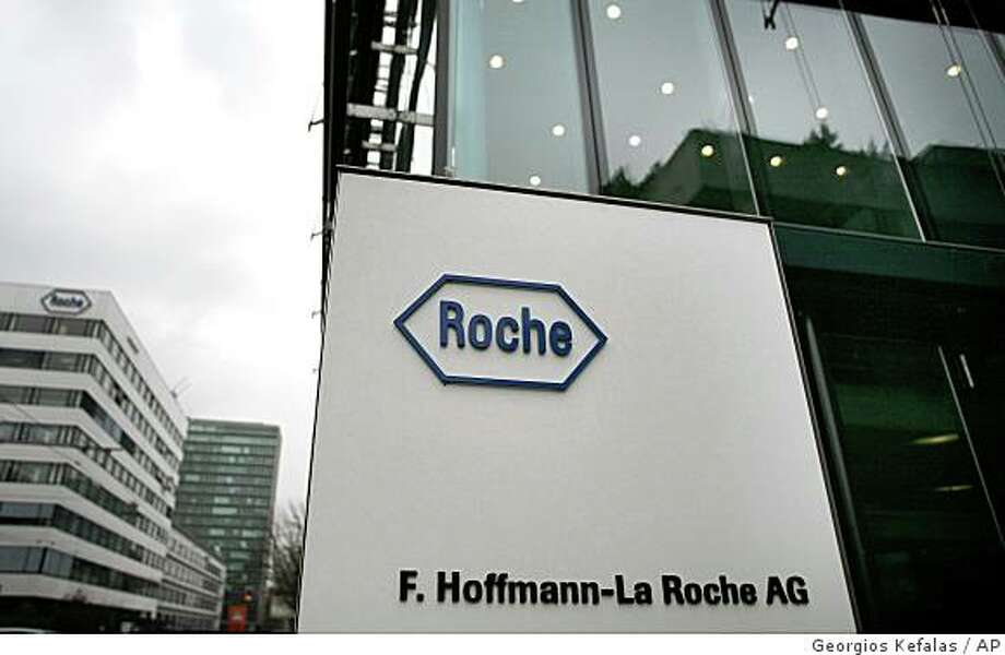 ** FILE ** In this March 16, 2006 file photo, the Roche buildings in Basle, Switzerland, are seen. Swiss pharmaceuticals company Roche Holding AG made a fresh bid to buy U.S.-based Genentech Inc. Friday, Jan. 30, 2009 by offering US$86.50 per share, US$2.50 less than its previous offer, directly to shareholders. (AP Photo/Keystone, fls/Georgios Kefalas, file) Photo: Georgios Kefalas, AP