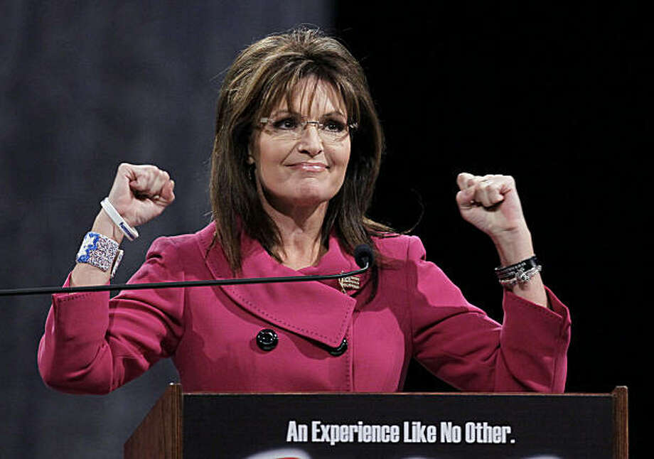 Former Republican vice presidential candidate Sarah Palin gestures as she addresses the National Quartet Convention in Louisville, Ky., Thursday, Sept. 16, 2010. Photo: Ed Reinke, AP