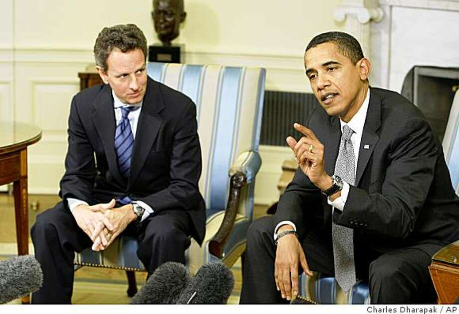 President Barack Obama speaks about the economy as Treasury Secretary Tim Geithner looks on in the Oval Office of the White House in Washington, Thursday, Jan. 29, 2009. (AP Photo/Charles Dharapak) Photo: Charles Dharapak, AP