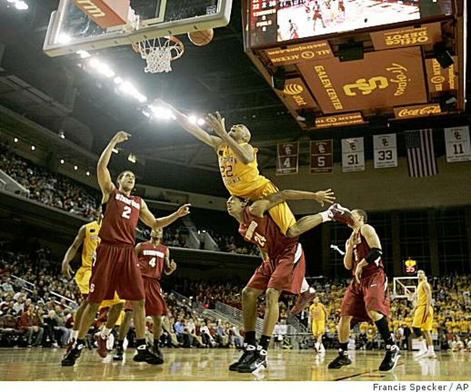 Southern California's Taj Gibson (22) shoots over the back of Stanford's Josh Owens (24) during the second half of an NCAA college basketball game in Los Angeles, on Thursday, Jan. 29, 2009. Gibson was called for an offensive foul. USC won 70-69. (AP Photo/Francis Specker) Photo: Francis Specker, AP