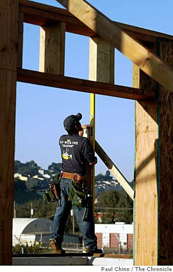 Alex Martinez levels a beam at the EcoCenter construction site at Heron's Head Park in San Francisco, Calif., on Thursday, Jan. 15, 2009. Construction of the environmentally-conscious interpretive center, slated to open in April, may be stalled because of the ongoing state budget crisis. Photo: Paul Chinn, The Chronicle