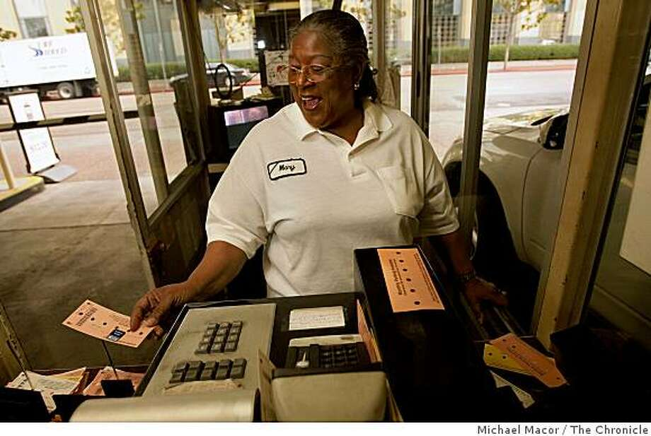 Mary Vance, deals with the public everyday as she waorks at the City Center Garage in downtown Oakland, Calif., as she keeps up a happy attitude while collecting fares from the public on Tuesday Dec. 23, 2008 Photo: Michael Macor, The Chronicle