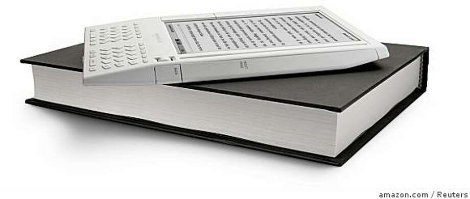 : The battery-operated Amazon Kindle, shown here in this image released to Reuters on November 19, 2007, let users download books, newspapers and blogs over a wireless connection. It can carry about 200 books downloaded from Amazon.com. Amazon.com, the world's largest Web  retailer, said on Monday that it will begin selling an electronic book reader with wireless access, the latest attempt to build consumer interest in portable reading devices.      REUTERS/Amazon.com/Handout  (UNITED STATES).  EDITORIAL USE ONLY. NOT FOR SALE FOR MARKETING OR ADVERTISING CAMPAIGNS. NO SALES. NO ARCHIVES. Ran on: 11-23-2007 Amazon's battery-operated Kindle lets users download books, newspapers and blogs over a wireless connection. The battery-operated Amazon Kindle, shown here in this image released to Reuters on November 19, 2007, let users download books, newspapers and blogs over a wireless connection. It can carry about 200 books downloaded from Amazon.com. Amazon.com, the world's largest Web retailer, said on Monday Photo: Amazon.com, Reuters