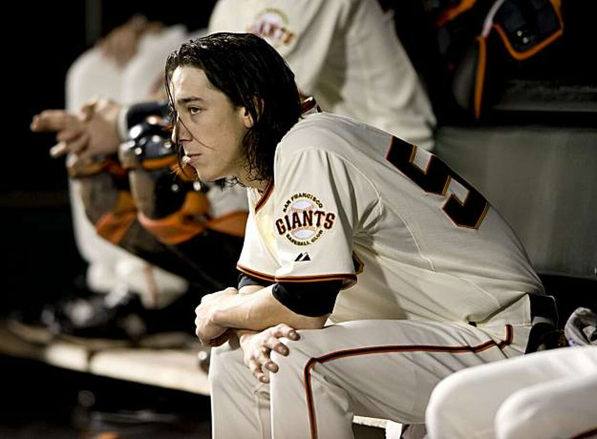 Tim Lincecum sits in the dugout after being taken out of the game as the San Francisco Giants take on the Milwaukee Brewers at AT&T Park in San Francisco, Calif., on Saturday, September 18, 2010.