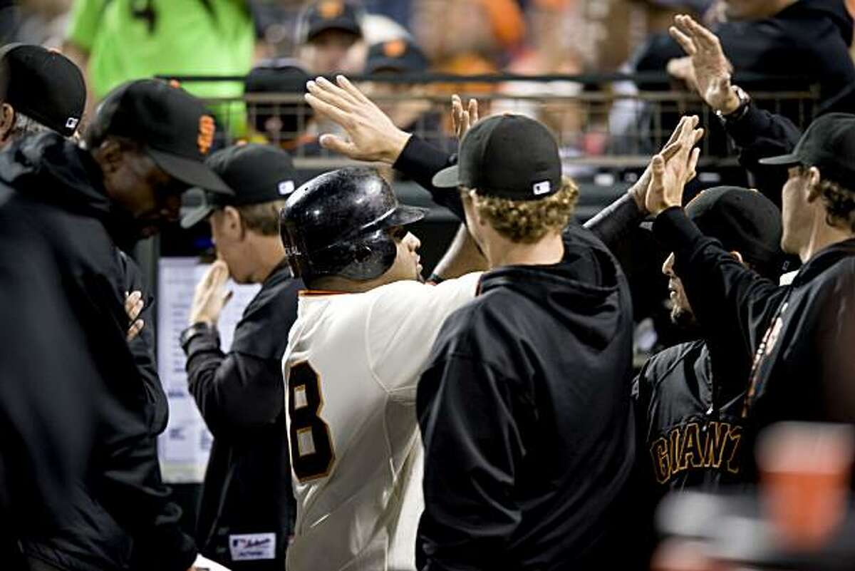 Pablo Sandovol is congratulated by teammates after scoring on a fielder's choice in the bottom of the 5th inning as the San Francisco Giants take on the Milwaukee Brewers at AT&T Park in San Francisco, Calif., on Saturday, September 18, 2010.
