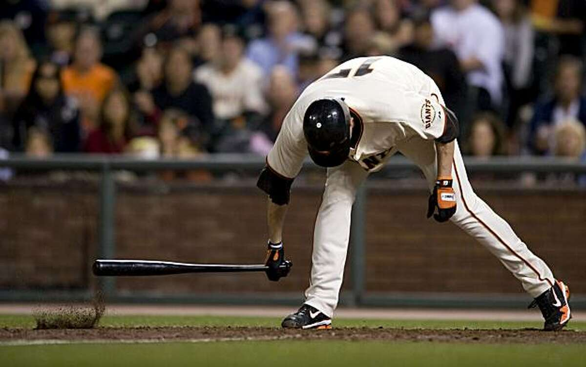 Aubrey Huff slams his bat into the ground after striking out in the bottom of the 9th inning The San Francisco Giants take on the Milwaukee Brewers at AT&T Park in San Francisco, Calif., on Saturday, September 18, 2010.