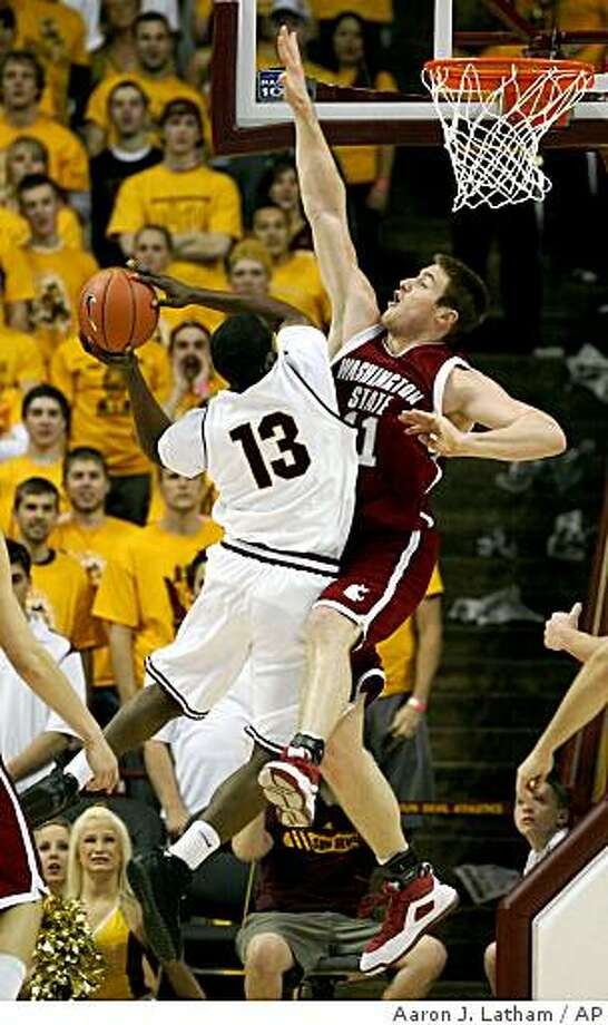 Arizona State's James Harden (13) tries to score under pressure from Washington State's Aron Baynes, right, during the first half of an NCAA college basketball game in Tempe, Ariz. Thursday Jan. 29, 2009. (AP Photo/Aaron J. Latham) Photo: Aaron J. Latham, AP