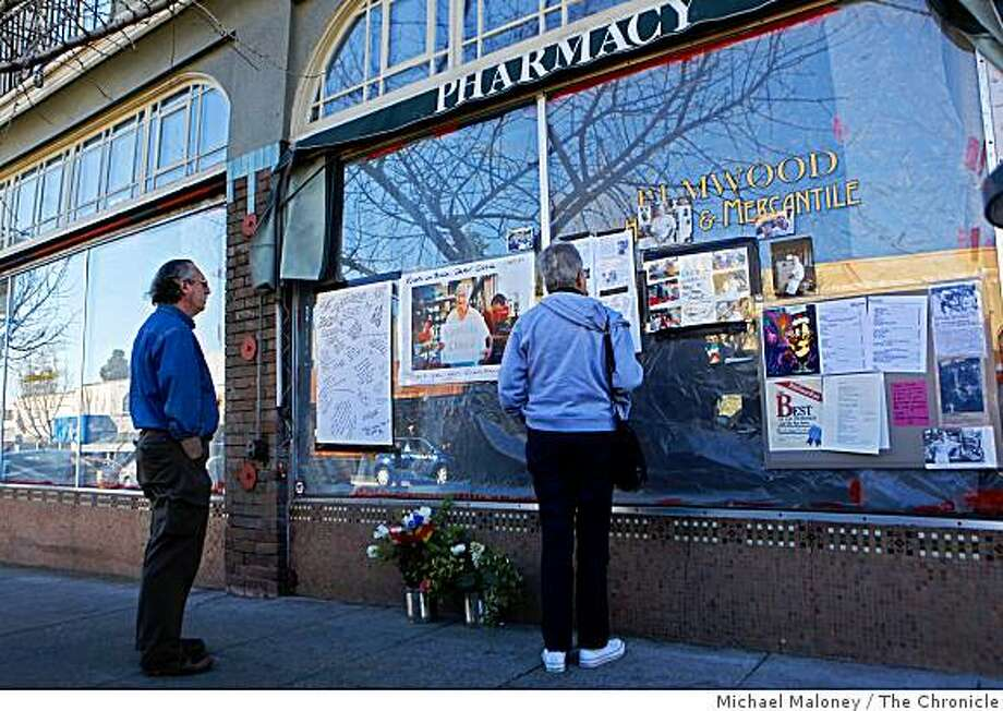 "Passerbys stop to read about the recent passing of Charles ""Ozzie"" Osborne who once worked at Ozzie's Soda Fountain on College Ave in Berkeley, Calif., on Sunday, February 1, 2009. A growing memorial was set up outside what was once the soda fountain shop. Photo: Michael Maloney, The Chronicle"