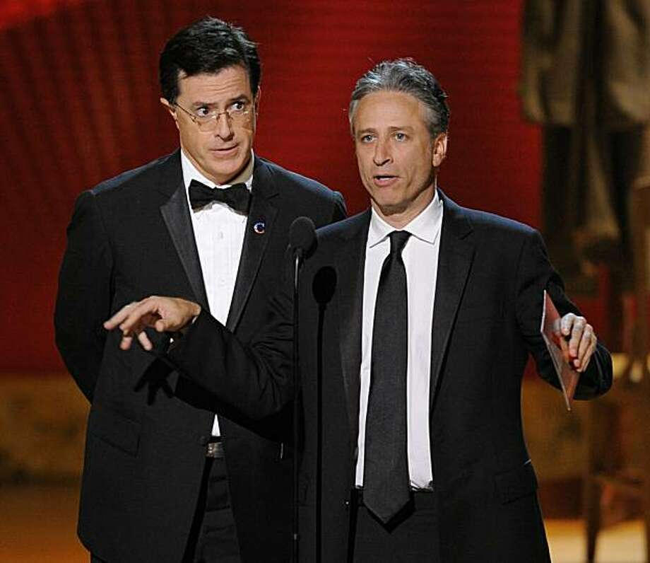 In this Sept. 21, 2008 file photo, Stephen Colbert, left, and Jon Stewart make an award presentation at the 60th Primetime Emmy Awards in Los Angeles. Photo: Mark J. Terrill, AP