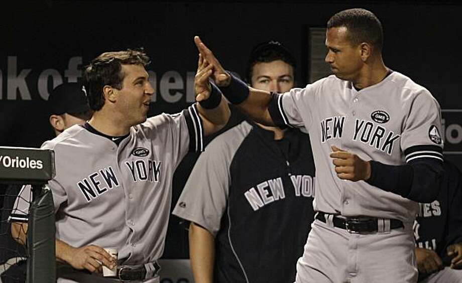 New York Yankees' Mark Teixeira, left, congratulates teammate Alex Rodriguez after Rodriguez hit a three-run home run against the Baltimore Orioles during the ninth inning of a baseball game, Friday, Sept. 17, 2010, in Baltimore. The Yankees won 4-3. Photo: Rob Carr, AP