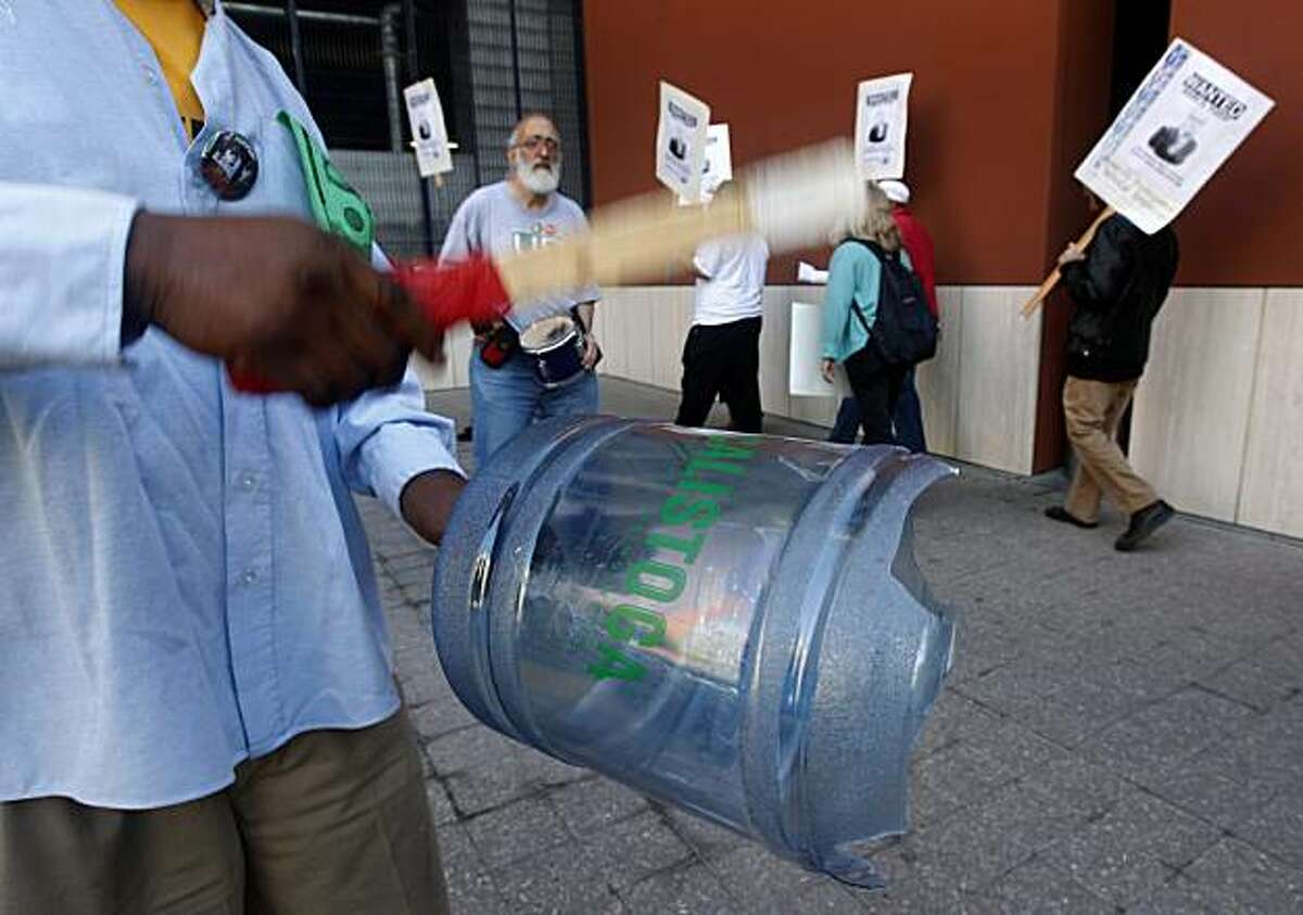 Victor Brown beats on a plastic water bottle, that eventually broke after the constant pounding, during a protest by unionized University of California employees outside of a meeting of the UC regents on the UCSF Mission Bay campus in San Francisco, Calif., on Thursday, Sept. 16, 2010. The employees are angry about proposed cuts to pension benefits.