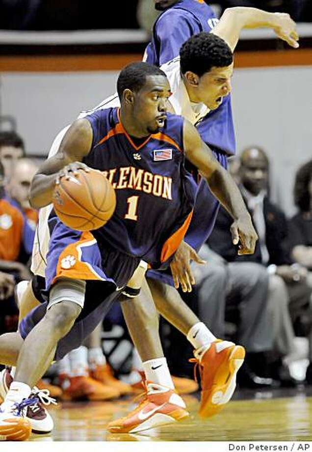 Clemson's K.C. Rivers dribbles around Virginia Tech's A.D. Vassallo during an NCAA college basketball game in Blacksburg, Va., Thursday, Jan. 29, 2009. Clemson won 86-82. (AP Photo/Don Petersen) Photo: Don Petersen, AP