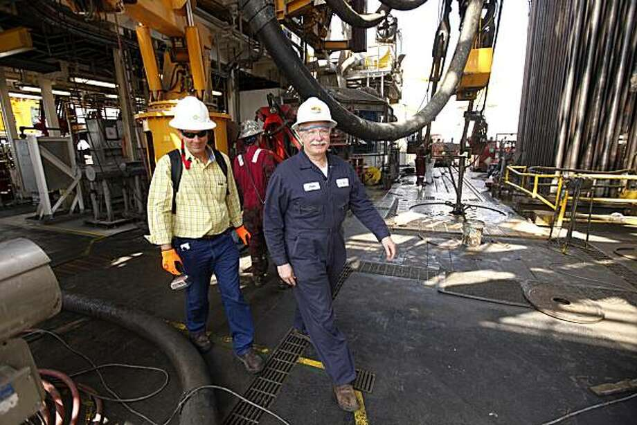 John Wright, right, the driller responsible for drilling the relief well to seal the Macondo well, the source of the Deepwater Horizon rig explosion and oil spill, walks across the drilling floor of the Development Driller III, after cement was poured into the well to seal it, in the Gulf Of Mexico, off the coast of Louisiana, Saturday, Sept. 18, 2010. Photo: Gerald Herbert, AP