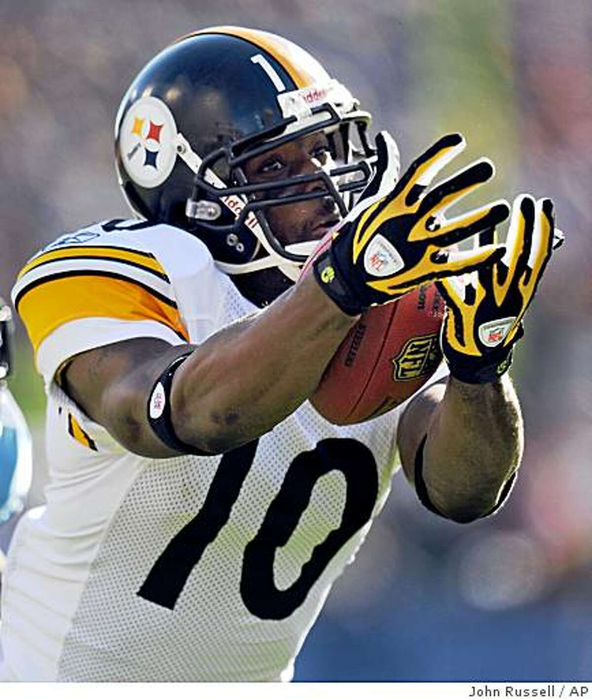 ** FILE ** In this Dec. 21, 2008 file photo, Pittsburgh Steelers wide receiver Santonio Holmes (10) catches a 31-yard touchdown pass against the Tennessee Titans during the second quarter of an NFL football game in Nashville, Tenn. Holmes reveals a childhood secret: He spent a year selling drugs on a small-town Florida street corner. He intentionally chose to use the biggest of stages, the Super Bowl, to make public the mistakes of his youth in hopes of persuading at-risk children to take a better course with their lives. (AP Photo/John Russell, File)