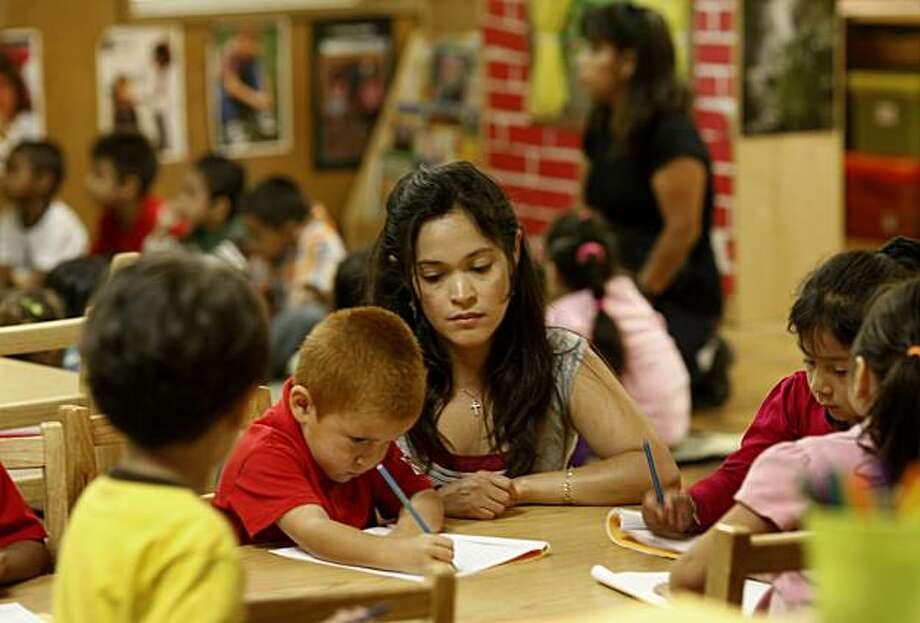 Assistant teacher Rosana Sandoval helps students with their drawing skills.  The teachers often run out of paper, crayons and paint. Teachers at Creative Montessori School in East Palo Alto, Calif. haven't been paid since July because of the California budget impasse. Photo: Brant Ward, The Chronicle