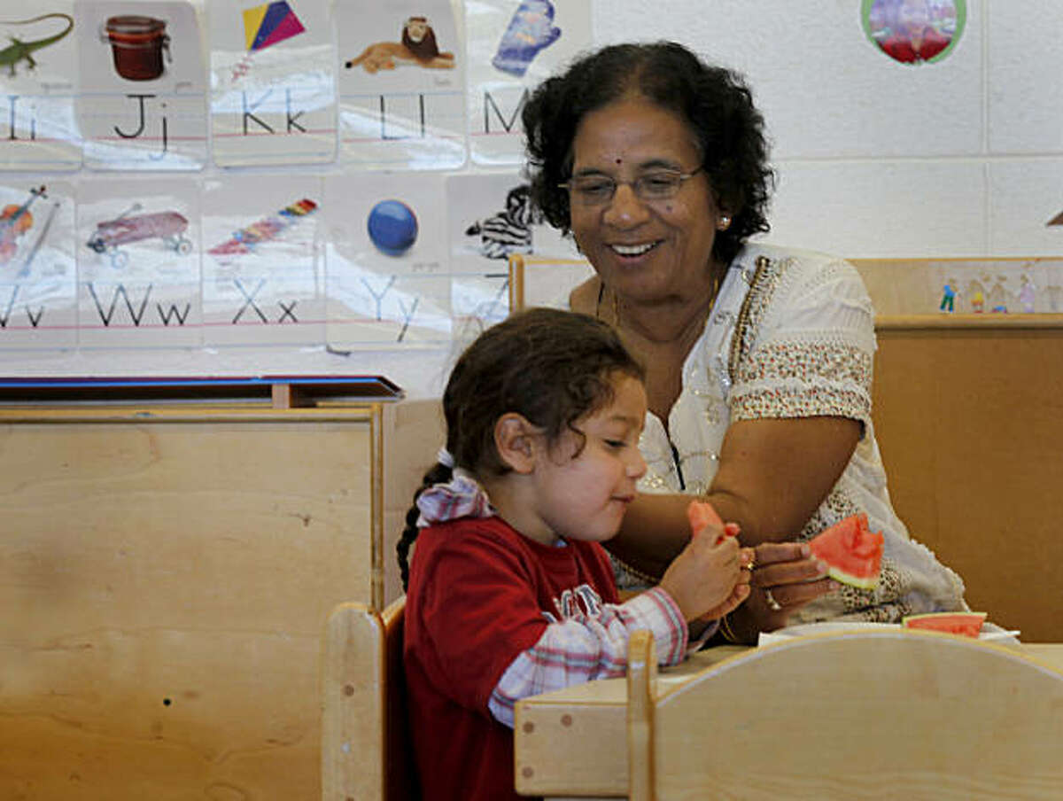 Sudha Gupta, who has been teaching at the Montessori School for eight years, smiled as she sat and ate a watermelon snack with her students. Teachers at Creative Montessori School in East Palo Alto, Calif. haven't been paid since July because of the California budget impasse.