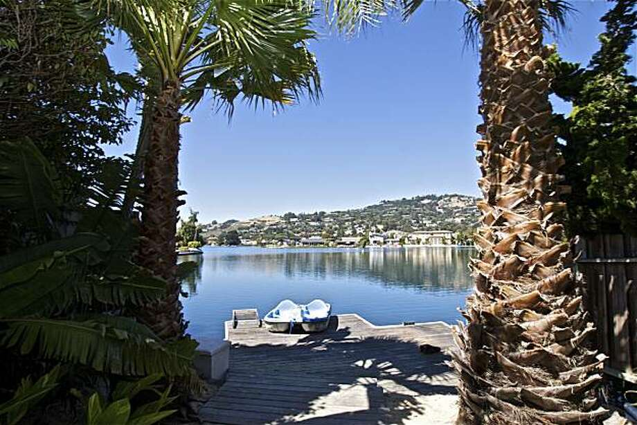 6 Leeward Road in Belvedere has a private path that leads to a deck on the shores of the Belvedere Lagoon. Photo: Courtesy Of Karin Larson