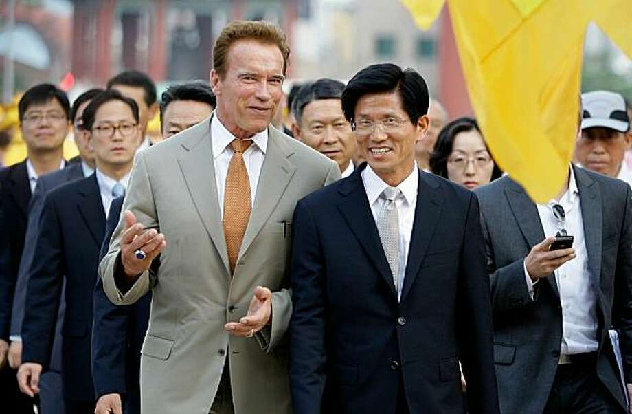 SUWON, SOUTH KOREA - SEPTEMBER 14:  California Governor Arnold Schwarzenegger (L) walks with Gyeonggi Province Governor Kim Moon-Soo during a visit at Hwaseong Haenggung Palace on September 14, 2010 in Suwon, South Korea. Governor Schwarzenegger visited Korea as part of a six-day trip through Asia to discuss trade to help boost California's economy and create jobs. Photo: Chung Sung-Jun, Getty Images